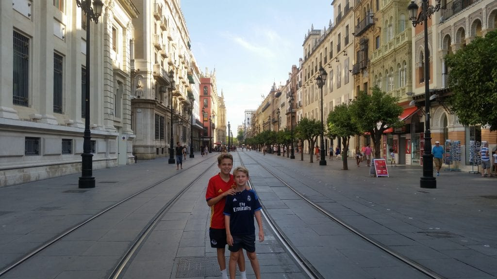 Our sons explore their new hometown of Seville, Spain
